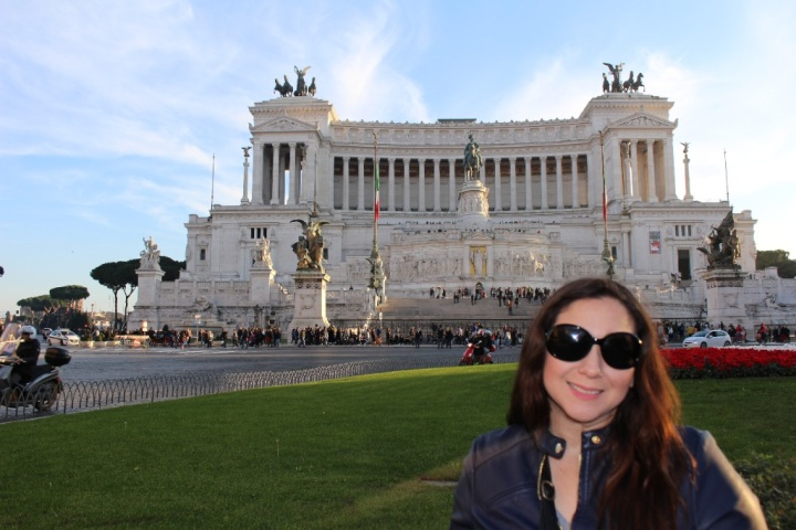 I am standing in front of the Wedding Cake monument aka Typewritter in Rome, Italy.